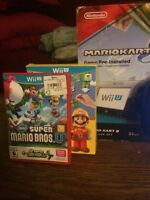 Wii U used plus games and cords asking for 300$