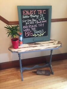 Antique sofa table and vintage window chalkboard