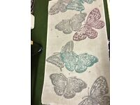 Grey rug with butterflies