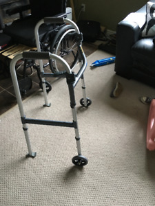 Invacare folding aluminum walker with 5' fixed wheels