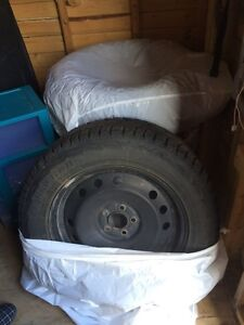 Four winter tires on steel rims 245/60/R18
