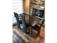 140cm dining table and 6 faux leather chairs with chrome finish
