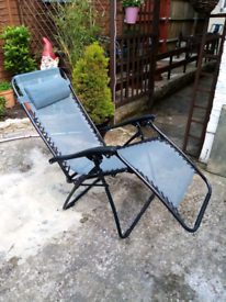 2 X GARDEN LOUNGERS. AS NEW. IN BLACK WITH HEAD REST.