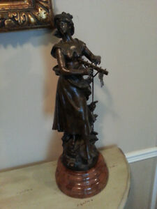 Bronze statue with marble base