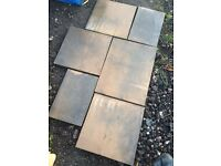 5.67m2 of mixed sized grey/brown garden slabs paving