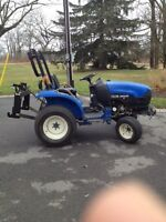 New holland tc 18 with snowblower and belly mower