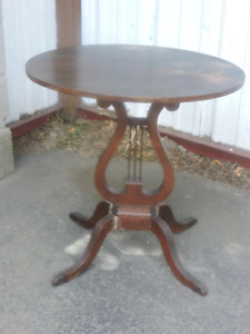 small oval harp table