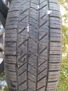 Alloy rims with near new all season tires