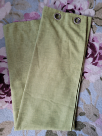 Pair of green eyelet Dunelm curtains 168cm x 183 cm