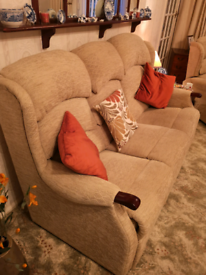 HSL 3 seater taupe sofa, 1 electric riser, and 1 manual recliner.