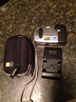 Fujifilm camera with charger and case