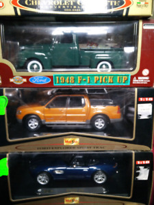 Cast cars new in box 1:18 scale