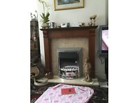 Electric fire, wooden fire place and marble hearth
