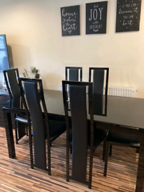 HARVEY'S Black table with 6 chairs