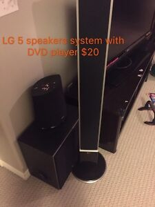 LG Surround sound 5 speaker system with sub and DVD player.