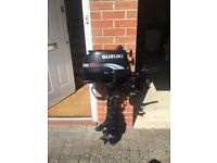 Suzuki 5hp four stroke outboard engine and small dingy