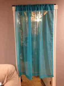 2 sheer blue curtain panels