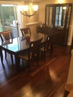 Charming solid wood dinning room table and hutch! Make it yours!