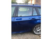 BMW e91 rear near side passenger door Le Mans blue