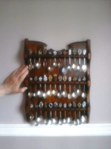 36 collectible spoons with wood frame that you hang on the wall