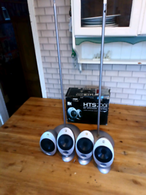 "Kef ""egg"" surround speakers."