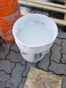 Pail of unmixed drywall mud