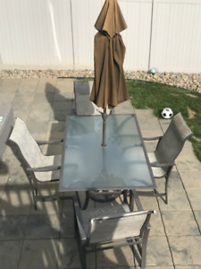 For SaleTempered Glass Top Patio Set c/w Umbrella base, 4 chairs