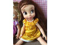 Disney Belle And Rapunzel dolls.