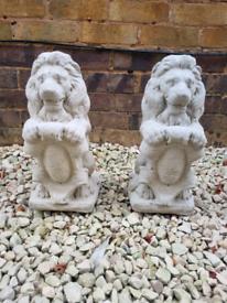 Pair stone shield lion statues