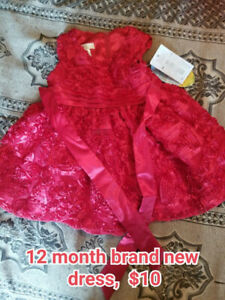 I have 2 Size 12 month Girls Spring Dresses...1 is NEW with tags