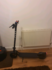 PURE ELECTRIC E SCOOTER NEW WITH BOX AND WARRANTY