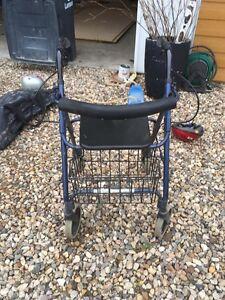 Walker with seat, brakes, and basket