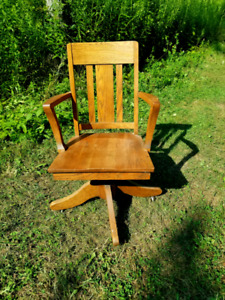 Oak arts and crafts chair it turns rolls tilts