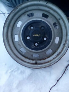4  15 inch jeep steel rims with centres