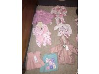 Brand new baby clothes with tags on