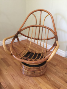 Two Swivel Rocking Rattan Chairs and the foot stool