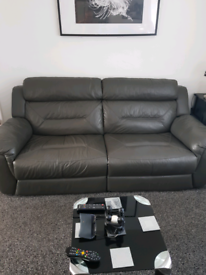 Grey Leather 3 seater reclining sofa and 1 chair non recliner