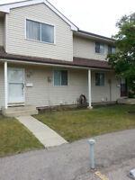 TOWN HOUSE IN FALCONRIDGE NE.AVAILBALE FOR RENT.