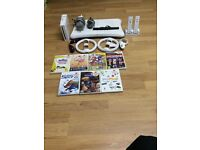Nintendo Wii bundle +Wii fit board +7 games good fully working condition