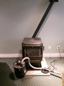 PELLET STOVE, CHIMNEY & ASH VACUUM & 2 cans cleaner FOR SALE