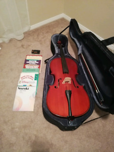 Full sized cello with music books