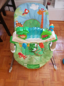 Gently Used Swing, Exersaucer, and Vibrating Chair