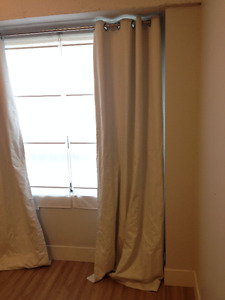 white textured blackout curtains with curtain rod