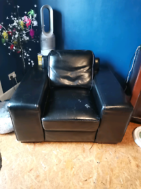Large black leather look armchair