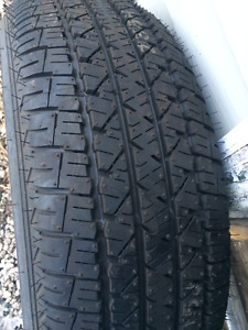 one new 215-55-17 tire