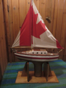 VINTAGE HAND MADE POND YACHT WITH STAND ASKING $135 OR BEST OFFE