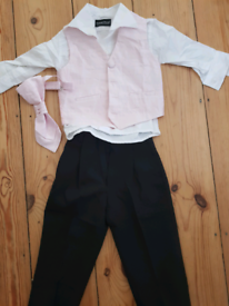 For sale is a baby event suit from Antonio Villini.