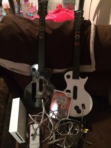 wii console and guitar hero and game