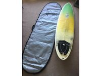 "6'10"" NS Surfboard and bag"