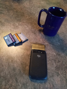 Blackberry Torch with spare batteries and Rim mug